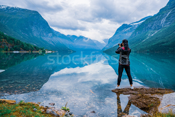 Nature photographer tourist with camera shoots lovatnet lake Bea Stock photo © cookelma