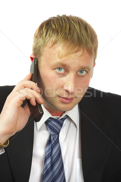 The businessman speaks by phone. Conducts conversation. Stock photo © cookelma