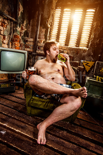 fat man eating hamburger Stock photo © cookelma