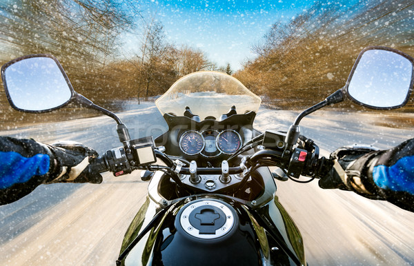 Biker First-person view. Winter slippery road Stock photo © cookelma