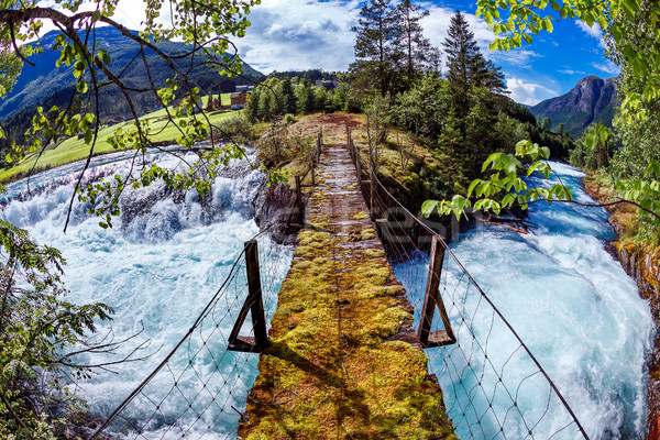 висячий мост горные реке Норвегия красивой природы Сток-фото © cookelma