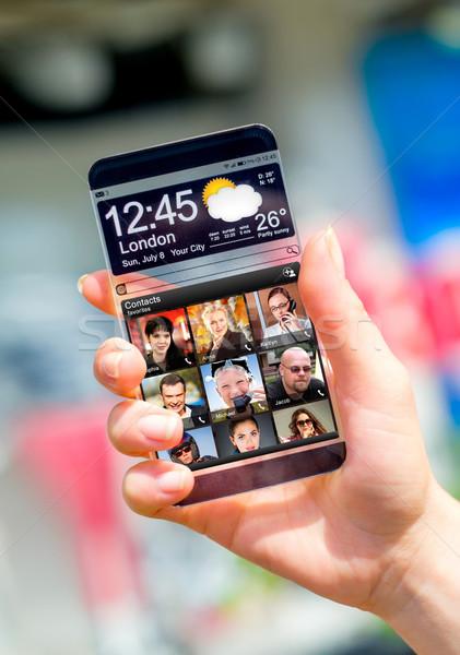 Smartphone transparant scherm menselijke handen futuristische Stockfoto © cookelma