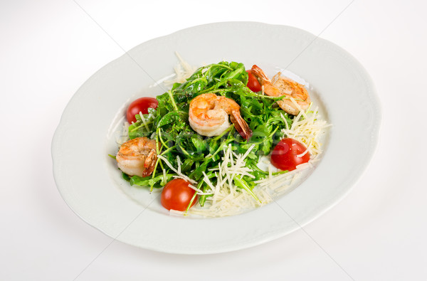 Salad from eruca and shrimps Stock photo © cookelma