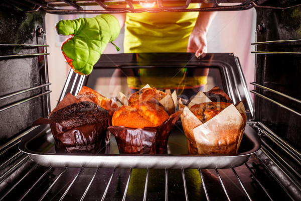 Baking muffins in the oven Stock photo © cookelma