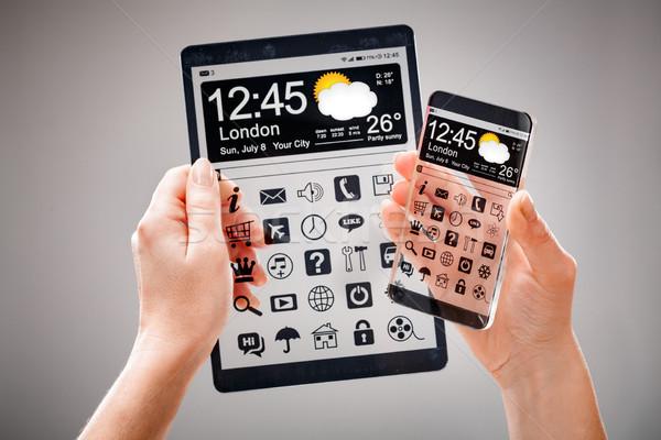 смартфон таблетка прозрачный экране человека рук Сток-фото © cookelma