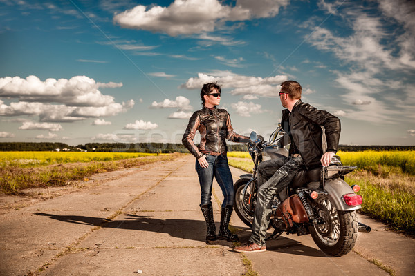 Bikers couple Man and woman near a motorcycle on the road Stock photo © cookelma