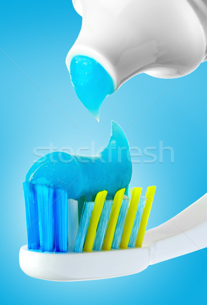 Dental brush and tube with paste. Stock photo © cookelma