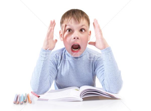 Uczeń chłopca książki za tabeli biały Zdjęcia stock © cookelma
