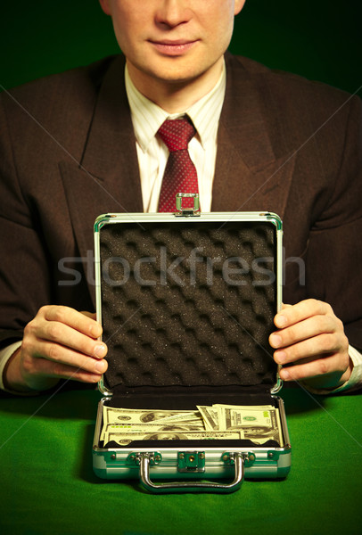 man's hand holds a suitcase with dollars Stock photo © cookelma