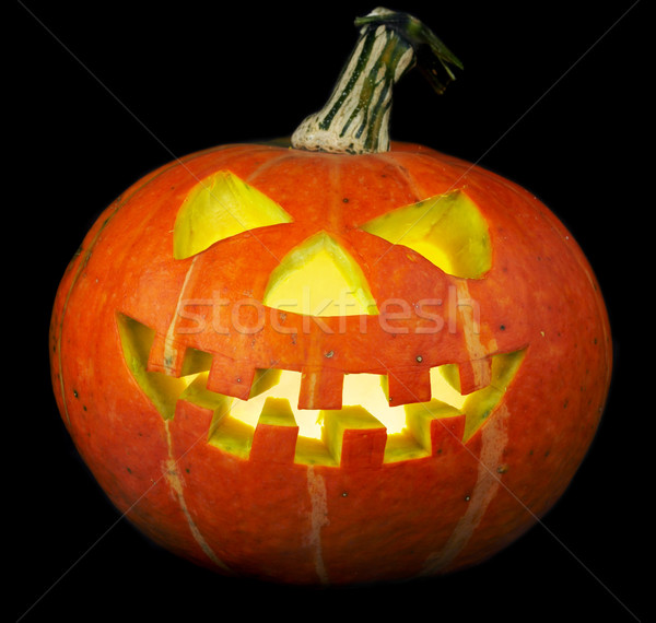 scary old jack-o-lantern on black. Stock photo © cookelma