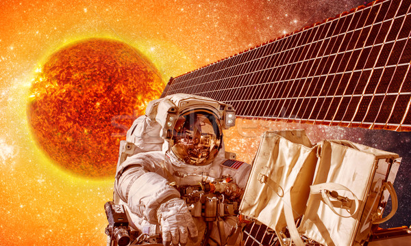 Spacecraft and astronauts in space on background sun star Stock photo © cookelma