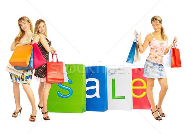 Vente sacs filles trois comparaison Shopping Photo stock © cookelma