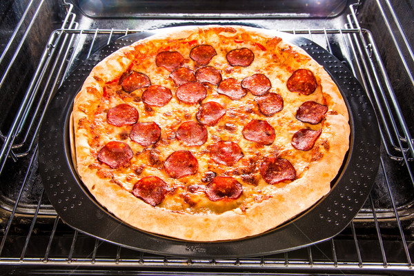 Pepperoni pizza in the oven. Stock photo © cookelma