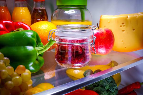 Frescos frambuesas vidrio jar plataforma abierto Foto stock © cookelma