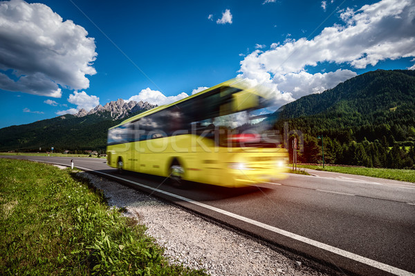 Yellow Public bus traveling on the road Stock photo © cookelma