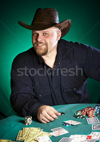 man with a beard plays poker Stock photo © cookelma