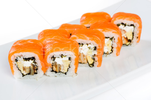 Sushi (Roll unagi maki syake) on a white background Stock photo © cookelma