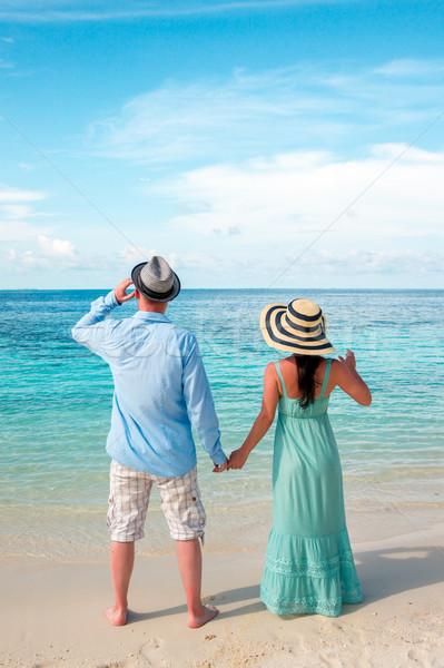 Tatil çift yürüyüş tropikal plaj Maldivler adam Stok fotoğraf © cookelma