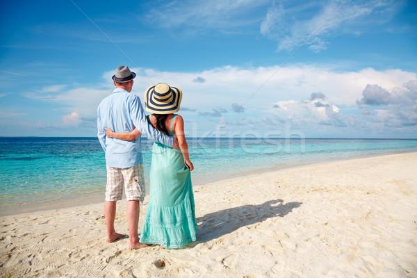 Vacation Couple walking on tropical beach Maldives. Stock photo © cookelma