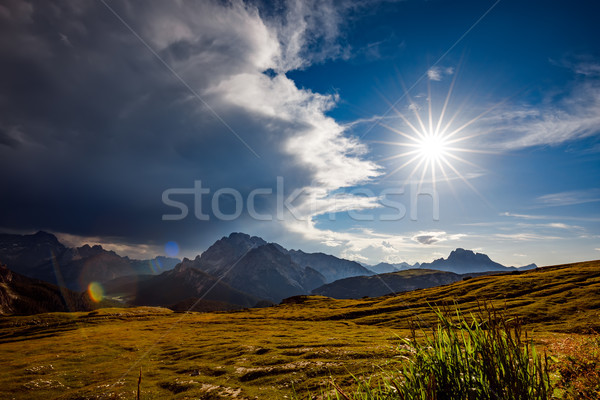 A storm cloud is coming in the sun. The beginning of the storm. Stock photo © cookelma