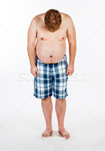 Overweight, fat man and scales. Stock photo © cookelma