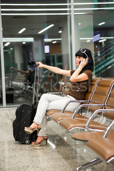 Woman with mobile phone in the airport Stock photo © cookelma