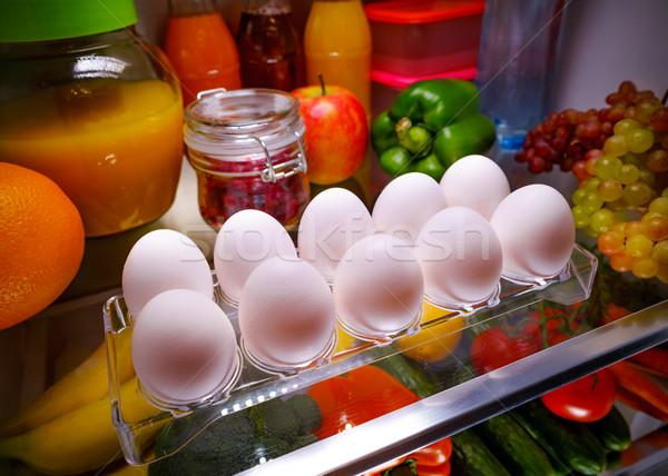 Chicken eggs on a shelf open refrigerator Stock photo © cookelma