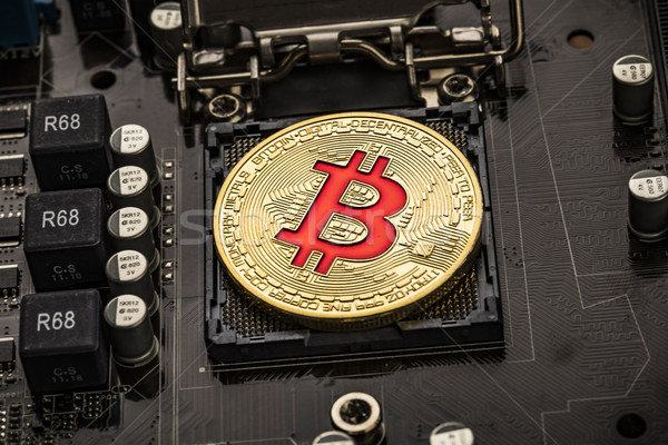 Or bit pièce pièces carte mère bitcoin Photo stock © cookelma