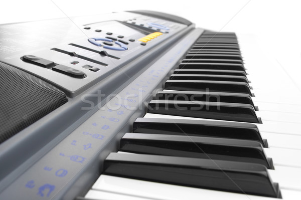 Keys of a synthesizer in white bright light. Stock photo © cookelma