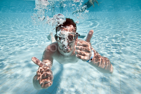Stock photo: man floats in pool