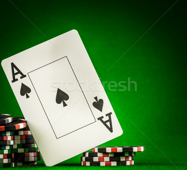 Stock photo: chips and two aces