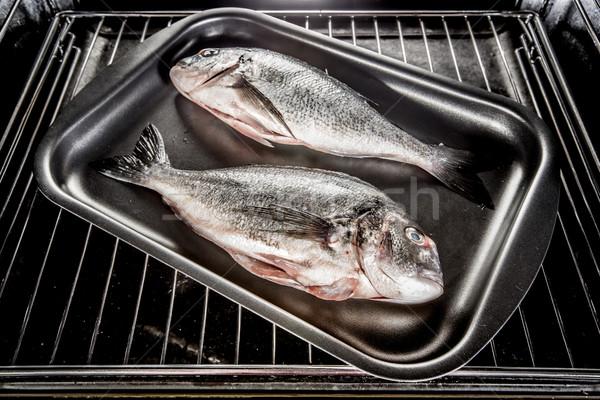 Dorado fish in the oven. Stock photo © cookelma