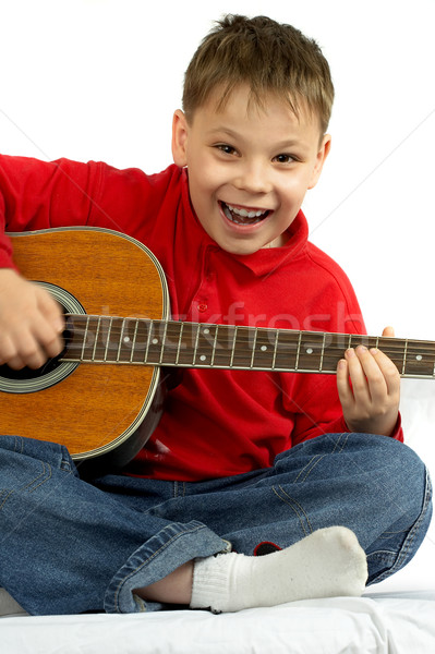 The boy with an acoustic guitar on a white background  Stock photo © cookelma