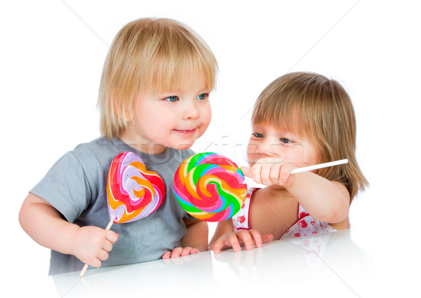 Babies eating a sticky lollipop Stock photo © cookelma