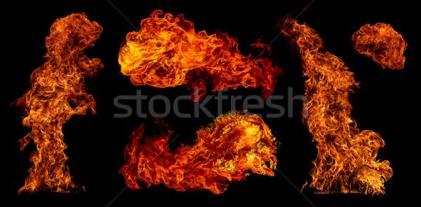 Brand ingesteld geïsoleerd zwarte achtergrond oranje Stockfoto © cookelma