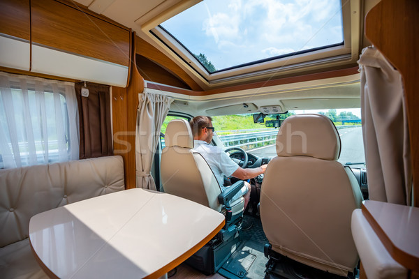 Man driving on a road in the Camper Van RV Stock photo © cookelma