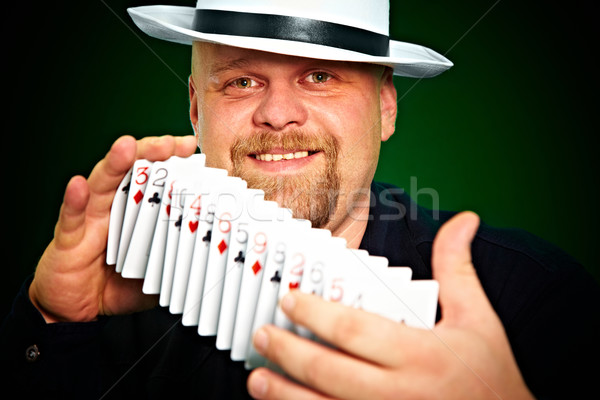 man skilfully shuffles playing cards Stock photo © cookelma