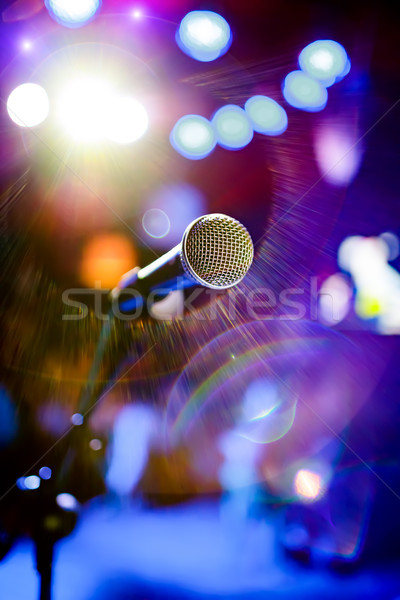 Microphone on stage against a background of auditorium. Stock photo © cookelma