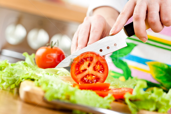 Woman's hands cutting vegetables Stock photo © cookelma