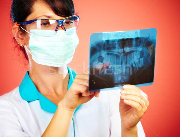 Médico raio x feminino mandíbula mão médico Foto stock © cookelma