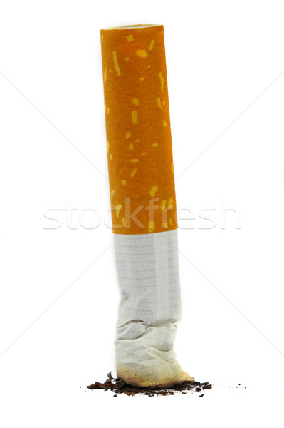Stock photo: The extinguished stub of a cigarette. A bad habit.