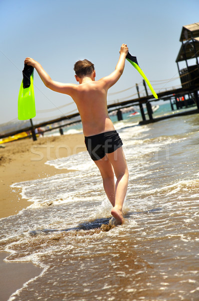 boy goes along seacoast Stock photo © cookelma