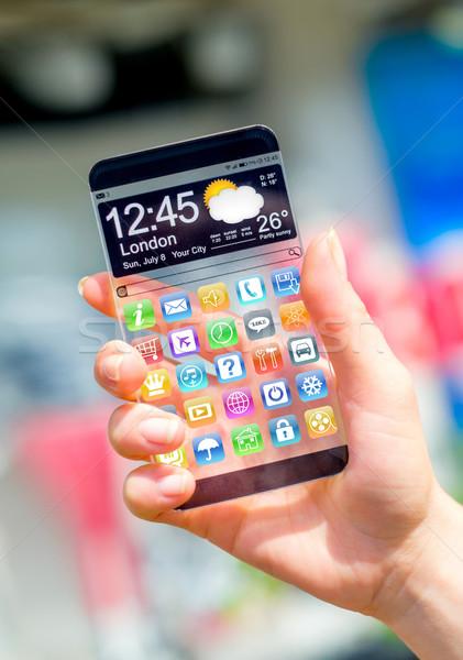 Okostelefon átlátszó képernyő emberi kezek futurisztikus Stock fotó © cookelma