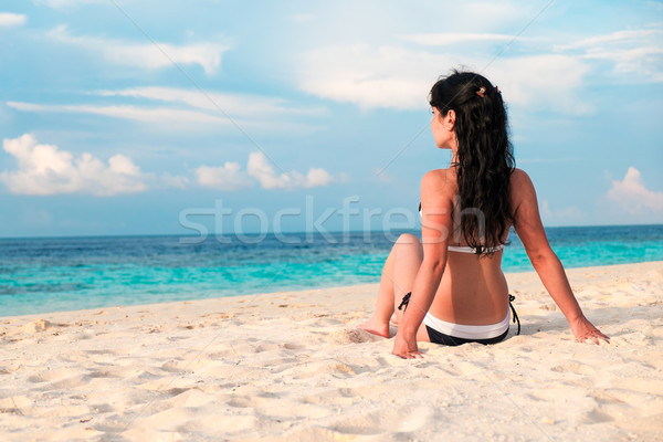 Girl walking along a tropical beach in the Maldives. Stock photo © cookelma
