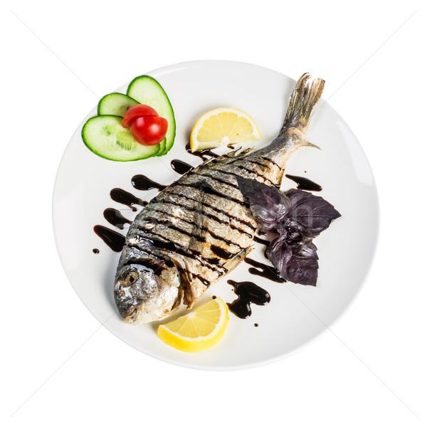 Dorado roast fish on the white Stock photo © cookelma