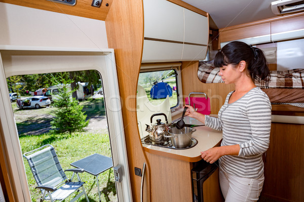 Woman cooking in camper, motorhome RV interior Stock photo © cookelma