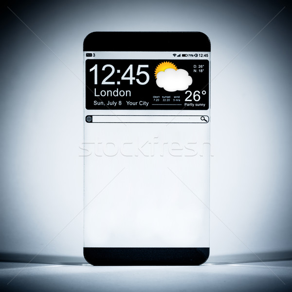 Smart phone (copy space display) with a transparent display. Stock photo © cookelma