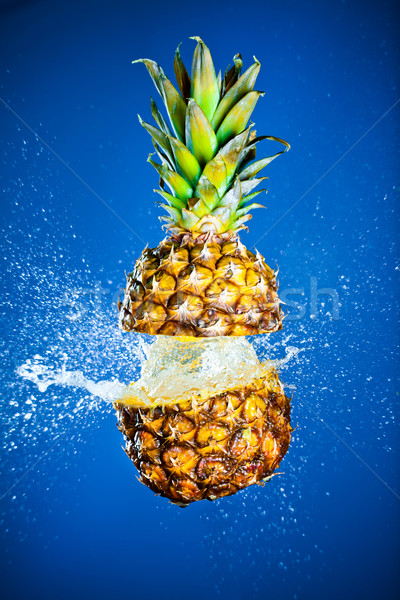 Pineapple splashed with water Stock photo © cookelma