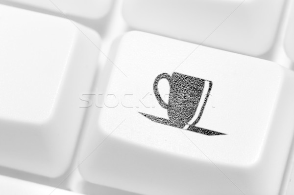 The button with an emblem of a cup of coffee on the keyboard. A  Stock photo © cookelma