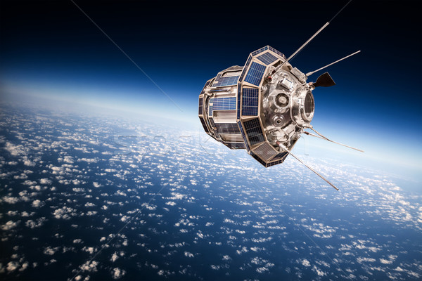 Space satellite over the planet earth Stock photo © cookelma